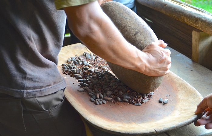 Cacao beans ground by hand